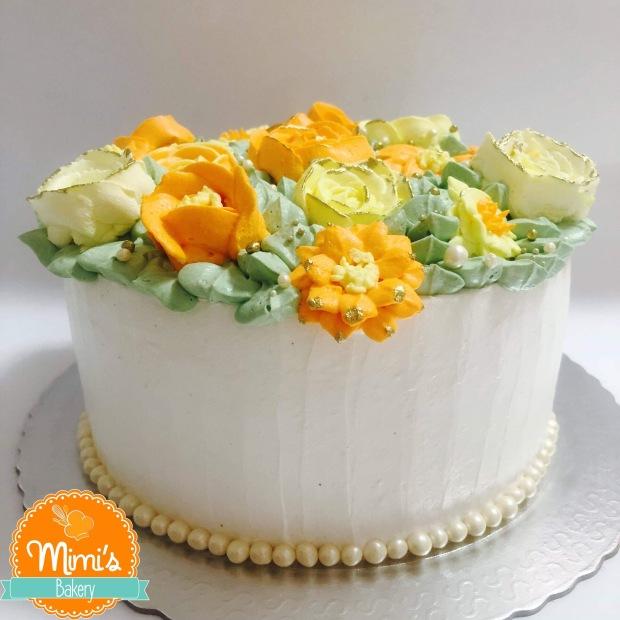 Cesta de flores amarelo e laranja